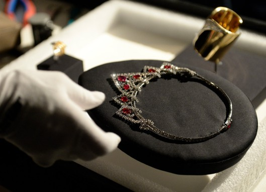 """ A Denver Art Museum installer placed Elizabeth Taylor's ruby and diamond Cartier necklace on display as they prepare on Thursday, November 6, 2014 for the upcoming show, ""Brilliant: Cartier in the 20th Century."""""