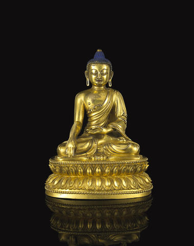 A gilt bronze seated figure of Buddha