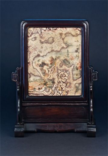 A hardstone and hongmu desk screen painted with figures in a mountainous landscape. China, late 19th century.