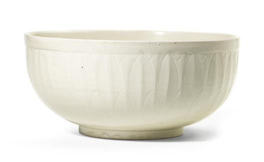A rare and large carved Dingyao 'fish' basin