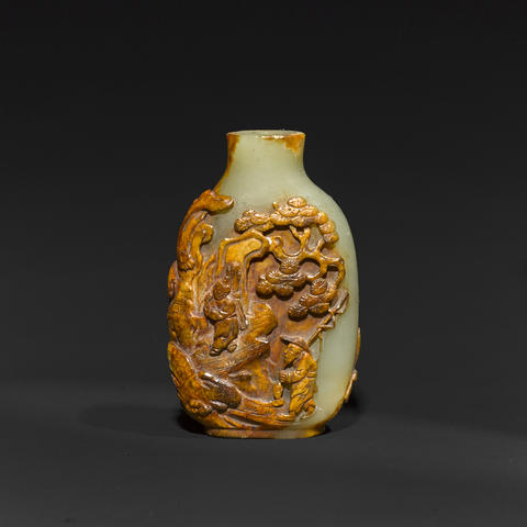 A yellowish-green nephrite snuff bottle with carved russet skin, Master of the Rocks School, 18th-19th century