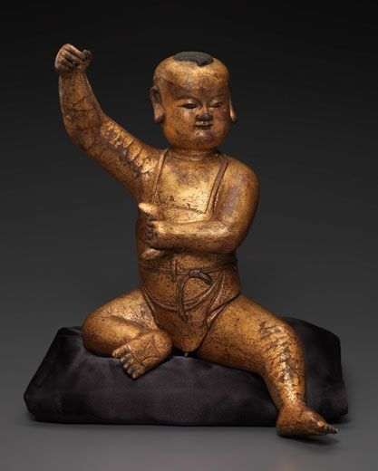 Gilt-Lacquered Wood Figure of a Seated Boy. China, Song-Yuan Dynasty